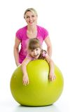 Mother doing gymnastics with kid on fitness ball. Mother doing gymnastics with daughter kid on fitness ball Stock Photography