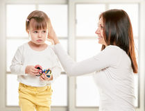 Mother doing her daughter s hair Stock Photography