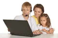 Mother doing homework with children Stock Photos