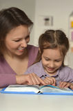 Mother doing homework with daughter Royalty Free Stock Images