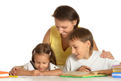 Mother doing homework with her kids. Happy Mother doing homework with her kids Royalty Free Stock Photography