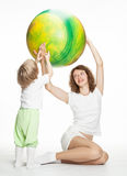 Mother doing sport exercises with daughter Stock Images