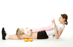 Mother doing sport exercises with her daughter Royalty Free Stock Photos