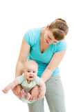 Mother doing yoga with baby Stock Image