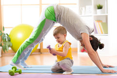 Mother doing yoga or fitness exercises with baby Royalty Free Stock Images