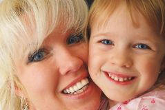 Mother and doughter. Portrait closeup fro three year old girl and blond mother. Happy family and childhood Stock Photo