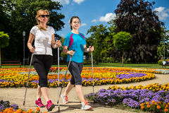 Mother and doughter nordic walking Royalty Free Stock Image