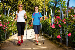 Mother and doughter nordic walking Royalty Free Stock Photos