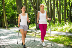 Mother and doughter nordic walking Stock Image