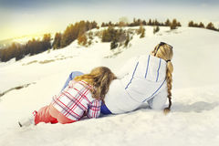 Mother and doughter resting on the snow Royalty Free Stock Image