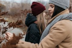 Mother and doughter teenager are walking on the street in warm autumn clothes stock images
