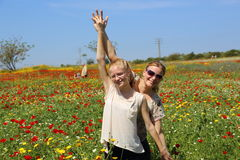 Mother and doughtier in nature. Mother and doughtier in wildflowers field Stock Image
