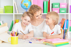 Mother drawing with cute sons Stock Image