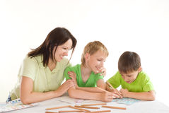 Mother draws with his sons Royalty Free Stock Image