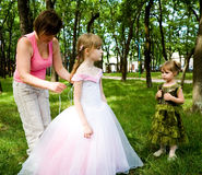 Mother dress a daughter royalty free stock images