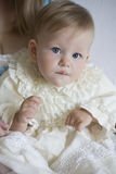 Mother dress up little baby Stock Photos
