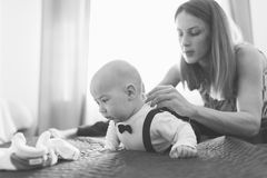 Mother dressing baby boy Royalty Free Stock Photos