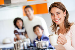 Mother drinking coffee Royalty Free Stock Photo