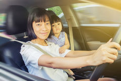 Mother drive car Royalty Free Stock Images