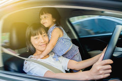 Mother drive car Royalty Free Stock Photo