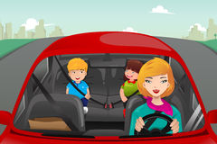 Mother driving with her children Royalty Free Stock Images