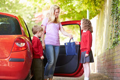 Mother Driving To School With Children stock image
