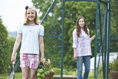 Mother Dropping Daughter Off For Tennis Lesson Stock Photography
