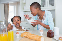 Mother and duaghter eating together Royalty Free Stock Photos