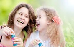 Mother and duaghter playing Royalty Free Stock Photos