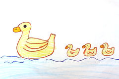 Mother duck and ducklings with crayon drawings. Stock Photo