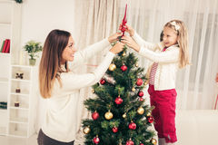 Mother And Dughter Decorating Christmas Tree Stock Image