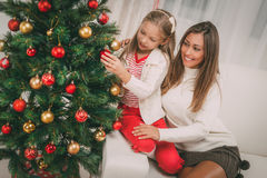Mother And Dughter Decorating Christmas Tree Stock Images