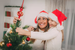 Mother And Dughter Decorating Christmas Tree Royalty Free Stock Photography