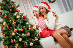 Mother And Dughter Decorating Christmas Tree Stock Photo