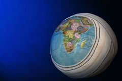 Mother Earth. Globe with bandage on a blue background Royalty Free Stock Photo