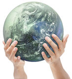 Mother Earth offered by hands. A blue and green globe or mother earth carried and offered by hands. Green concept of ecology and CO2. Isolated over white. Globe stock photos