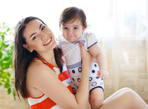 Mother with eight month old baby girl indoor Stock Photo