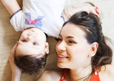 Mother with eight month old baby girl indoor Stock Images