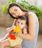 Mother with eight month old baby girl indoor Royalty Free Stock Photography