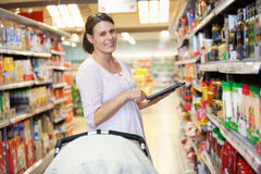 Mother with Electronic Shopping List Stock Photo