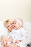 Mother embrace her baby girl Stock Photos