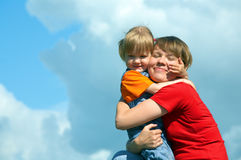 Mother embrace little daughter Stock Photos