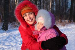 Mother embraces daughter in winter Royalty Free Stock Images