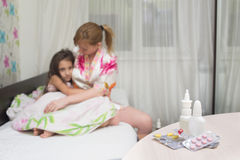 Mother embraces the sick child. sore throat, flu Stock Photography