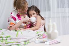 Mother embraces the sick child. sore throat, flu Stock Images