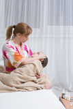 Mother embraces the sick child. sore throat, flu Stock Photos