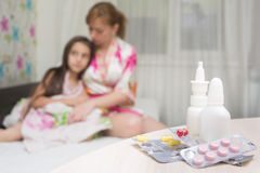 Mother embraces the sick child. sore throat, flu. Mother embraces the sick child. sore throat royalty free stock photo