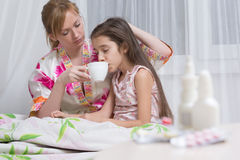 Mother embraces the sick child. sore throat, flu Royalty Free Stock Photography