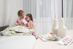 Mother embraces the sick child. sore throat, flu. Mother embraces the sick child. sore throat royalty free stock images