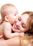 Mother embracing baby Stock Images